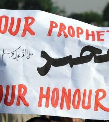 In this photo, a placard with text, 'Our Prophet Muhammad (PBUH), Our Honour,' could be seen at a rally in Islamabad.